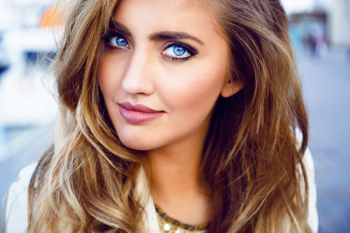 portrait of seductive sexy woman with big blue eyes